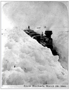 A train stuck in the snow during the winter of 1881. Man on top of train provided for scale. (Photo: Minnesota Historical Society)