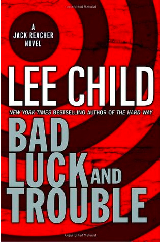 The cover of Bad Luck and Trouble has a red background on which circles from a bullet target are drawn in black