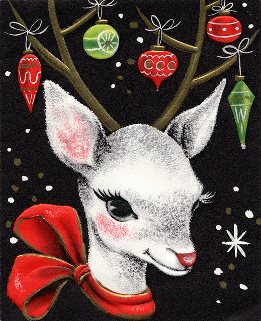 Chalk drawing of a white reindeer with green and red ornaments hanging from his antlers and a red bow around his neck against a black, snowflake-studded background.